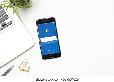 CHIANG MAI, THAILAND - May 02, 2017: The Facebook iOS application is launching on iPhone. The login screen is showing. Facebook is the social network application that connects people together online.