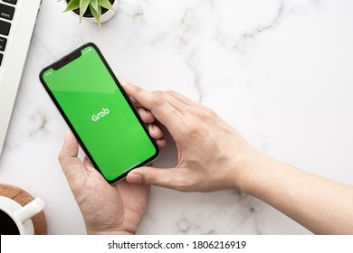 CHIANG MAI, THAILAND - May 04,2020: Apple iPhone with Grab application on the screen. Grab is a smartphone application for booking cars, ordering food and etc.