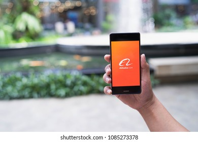 CHIANG MAI, THAILAND - May 05,2018: Man hands holding HUAWEI with alibaba apps on screen. Alibaba's the the world's biggest online commerce company. It's three main sites Taobao,Tmall and Alibaba.