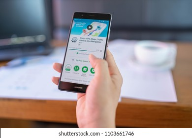 CHIANG MAI, THAILAND - May 06,2018: Man hands holding HUAWEI with Waze app on the screen. Waze is the world's largest community based traffic and navigation app.