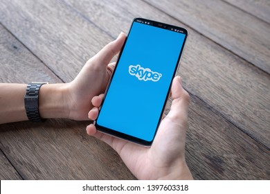 CHIANG MAI, THAILAND - May 11 ,2019 : Male holding Oneplus 6 with skype apps. Skype is part of Microsoft, can make video, audio calls, chat messages and do much more using Skype.
