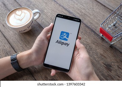 CHIANG MAI, THAILAND - May 11, 2019 : Male holding Oneplus 6 with Alipay logo, Alipay is application from china.