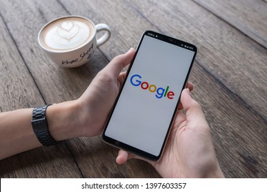 CHIANG MAI, THAILAND - May 11 2019: Male hands holding Oneplus 6 with Google Drive apps on screen. Google Drive is a free service from Google that allows you to store files online.