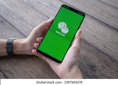 CHIANG MAI, THAILAND - May 11, 2019 : Man holds Oneplus 6 with WeChat app on the screen.WeChat is a Chinese multi-purpose messaging, social media and mobile payment app