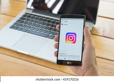 CHIANG MAI, THAILAND - MAY 11, 2016: Man hand holding LG G4 with screen shot of new Instagram application and new logo using LG G4. Instagram is largest and most popular photograph social networking.