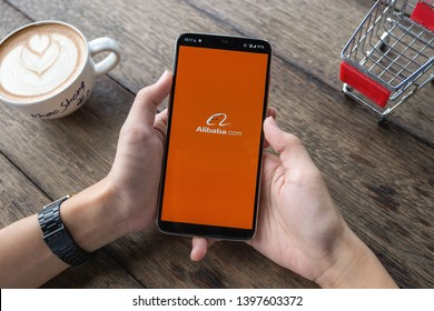 CHIANG MAI, THAILAND - May 11,2019: Man hands holding Oneplus a with alibaba apps on screen. Alibaba the the world biggest online commerce company. Its thAree main sites Taobao,Tmall and Alibaba.