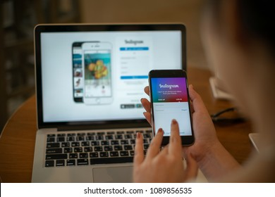 CHIANG MAI, THAILAND - MAY 14, 2018: A woman hand holding iphone with login screen of instagram application. Instagram is largest and most popular photograph social networking.