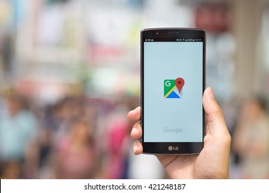CHIANG MAI, THAILAND - MAY 14, 2016: Man hand holding LG G4 with Google Maps application o. Google Maps is a service that provides information about geographical regions and sites around the world.
