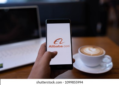 CHIANG MAI, THAILAND - May 19,2018: Man hands holding HUAWEI with alibaba apps on screen. Alibaba's the the world's biggest online commerce company. It's three main sites Taobao,Tmall and Alibaba.