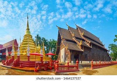 CHIANG MAI, THAILAND - MAY 2, 2019: Panorama of Wat Phan Tao with golden chedi, topped with hti umbrella, tall mini-chedis, carved white mondops and medieval teak viharn, on May 2 in Chiang Mai