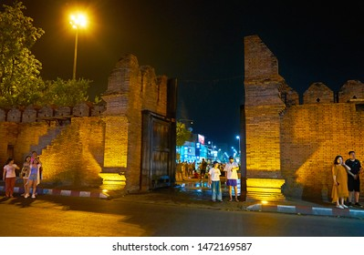 CHIANG MAI, THAILAND - MAY 2, 2019: The evening walk around medieval fortress wall and extant Tha Pae Gate, on May 2 in Chiang Mai