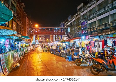 CHIANG MAI, THAILAND - MAY 2, 2019: The alley with numerous garment stalls of Warorot Market stretches along the Chiang Moi Road, on May 2 in Chiang Mai