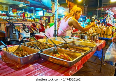 CHIANG MAI, THAILAND - MAY 2, 2019: The street food stall in Warorot Market with vegetable, pork and chicken stew, on May 2 in Chiang Mai