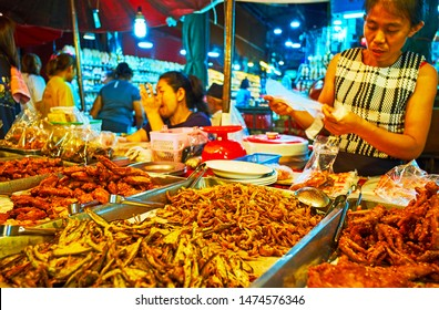 CHIANG MAI, THAILAND - MAY 2, 2019: The heaps of deep fried fish, chicken and pork in a stall of Warorot Market, on May 2 in Chiang Mai