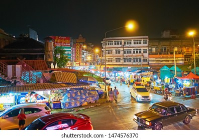 CHIANG MAI, THAILAND - MAY 2, 2019: The busy Praisanee Road at the Warorot Night Market with its numerous illuminated stalls and street vendors, on May 2 in Chiang Mai