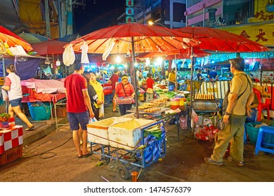 CHIANG MAI, THAILAND - MAY 2, 2019: The numerous food stalls are sandwiched by each other in Warorot Night Market, on May 2 in Chiang Mai