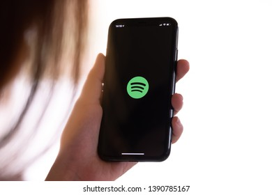 CHIANG MAI ,THAILAND MAY 21 2019 : Woman hand holding iPhone Xs with Spotify logo on the screen.