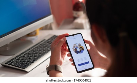 CHIANG MAI, THAILAND - MAY 24, 2020 : A working from home employee is downloading the Microsoft Teams social platform,
