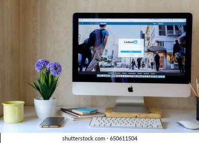 CHIANG MAI ,THAILAND MAY 31 2017 : Apple iMac 24,5 inch desktop computer with page social network service LinkedIn on the screen at white workspace.