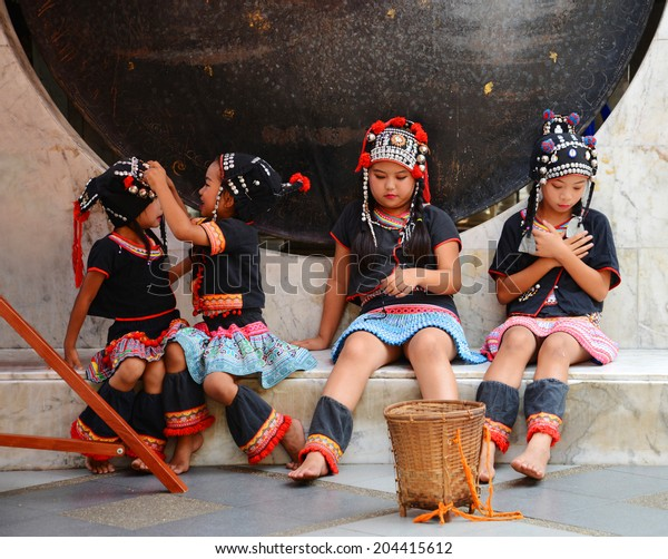 CHIANG MAI, THAILAND - MAY 4th 2013: Unidentified Hmong dancers dressed with traditional costumes perform at Doi Suthep temple, in the mountains around Chiang Mai (Thailand) for Songkran (Thailand's new year)