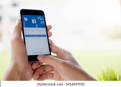 CHIANG MAI ,THAILAND - MAY 9 2019 : Woman hand holding iPhone 6s to use facebook with new login screen.Facebook is a largest social network and most popular social networking site in the world.