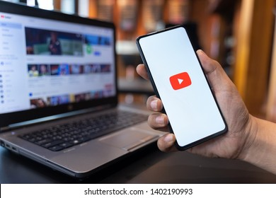 CHIANG MAI, THAILAND - May.01,2019: Man holding Xiaomi Mi Mix 3 with Youtube apps on screen. YouTube is the popular online video sharing website.