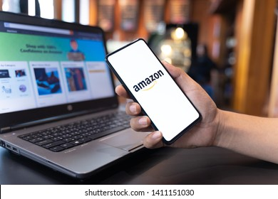 CHIANG MAI, THAILAND - May.01,2019: Man holding Xiaomi Mi Mix 3 with Amazon apps on screen. Amazon is an American international electronic commerce company. It is the world's largest online retailer.