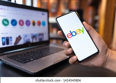 CHIANG MAI, THAILAND - May.01,2019: Man holding Xiaomi Mi Mix 3 with eBay apps on the screen. eBay is one of the most popular ways to buy and sell goods and services on the internet.