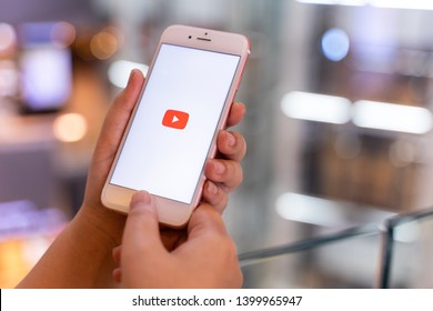 CHIANG MAI, THAILAND - May.01,2019: Woman holding Apple iPhone 6S Rose Gold with Youtube apps on screen. YouTube is the popular online video sharing website.