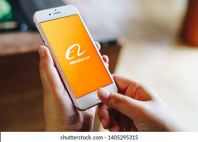 CHIANG MAI, THAILAND - May.01,2019: Woman holding Apple iPhone 6S with alibaba apps on screen.Alibaba is the the world is biggest online commerce company.Its three main sites Taobao,Tmall and Alibaba.