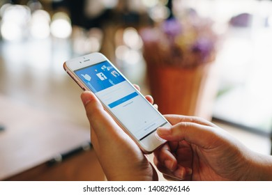 CHIANG MAI, THAILAND - May.01,2019: Woman holding Apple iPhone 6S Rose Gold with facebook app on the screen. Facebook is a popular free social  media are used for information sharing and networking.