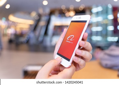 CHIANG MAI, THAILAND - May.10,2019: Woman holding Apple iPhone 6S with alibaba apps on screen.Alibaba is the the world is biggest online commerce company.Its three main sites Taobao,Tmall and Alibaba.