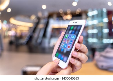 CHIANG MAI, THAILAND - May.10,2019: Woman holding Apple iPhone 6S Rose Gold with icons of social media on screen. Social media are most popular tool. Smartphone lifestyle. Starting social media app.