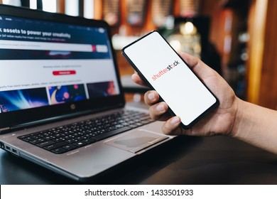 CHIANG MAI, THAILAND - May.11,2019: Woman holding Apple iPhone 6S Rose Gold with Shutterstock on screen. Shutterstock is a world leader in stock photography, vectors, illustrations, and video.