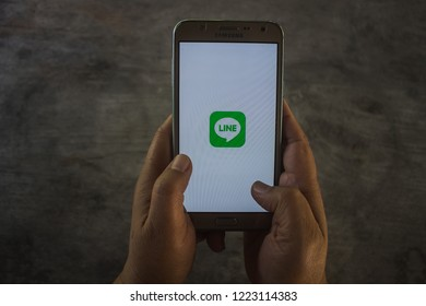 CHIANG MAI, THAILAND - NOV 07,2018: Woman holding samsung with LINE apps on screen. LINE is a new communication app which allows you to make free voice calls and send free messages.
