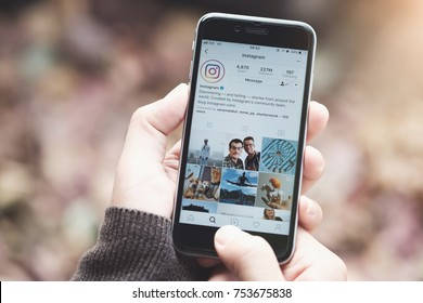CHIANG MAI, THAILAND - NOV 10, 2017: A man holds Apple iPhone with Instagram application on the screen. Instagram is a photo-sharing app for smartphones.