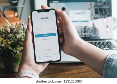 CHIANG MAI, THAILAND - NOV 12 ,2018: Woman holding iphone X mobile phone with Linkedin application on the screen. Linkedin is a business and employment oriented social networking service.