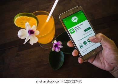 CHIANG MAI, THAILAND - NOV 12,2018: Woman holding samsung with LINE apps on screen. LINE is a new communication app which allows you to make free voice calls and send free messages.