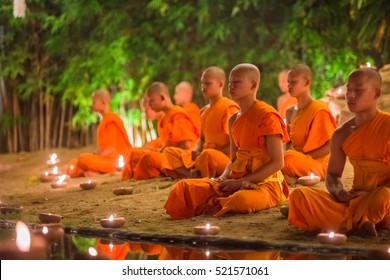 CHIANG MAI, THAILAND - NOV 14: Buddhist monks sit meditation under a Bodhi Tree at the Wat Pan Tao, dedicated to a Buddhist festival in November, 2016 in Chiang mai, Thailand.