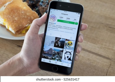 CHIANG MAI, THAILAND - NOV 14,2016: A women holds Apple iPhone 6S with Instagram application on the screen. Instagram is a photo-sharing app for smartphones.