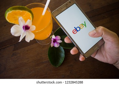 CHIANG MAI, THAILAND - NOV 19,2018: Woman hands holding samsung with eBay apps on the screen. eBay is one of the most popular ways to buy and sell goods and services on the internet.