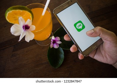 CHIANG MAI, THAILAND - NOV 19,2018: Woman holding samsung with LINE apps on screen. LINE is a new communication app which allows you to make free voice calls and send free messages.