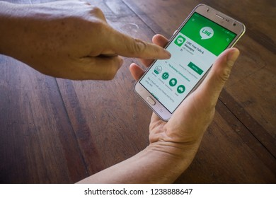 CHIANG MAI, THAILAND - NOV 26,2018: Woman holding samsung with LINE apps on screen. LINE is a new communication app which allows you to make free voice calls and send free messages.