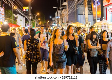 CHIANG MAI, THAILAND - NOV 27: People walk among stalls at famous Sunday walking street on November 27, 2016 in Chiang Mai, Thailand. Market is opened every Sunday from 4pm till midnight.