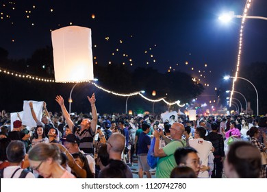 CHIANG MAI, THAILAND - NOV 3: Foreign tourists launch laterns during the Yi Peng / Loi Krathong festival on November 3, 2018 in Chiang Mai, Thailand