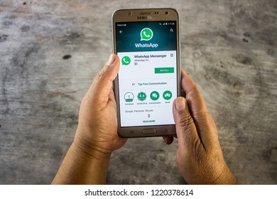 CHIANG MAI, THAILAND - NOV 5,2018 : Man holding a samsung and open appstore searching social Internet service WhatsApp on the screen. samsung was created and developed by the Apple inc.