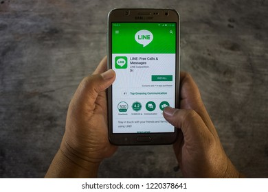 CHIANG MAI, THAILAND - NOV 5,2018: Woman holding samsung with LINE apps on screen. LINE is a new communication app which allows you to make free voice calls and send free messages.