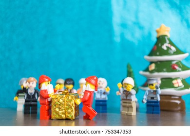 CHIANG MAI , THAILAND - November 12, 2017 Lego Santa Claus minifigure with Christmas scene on wooden floor and blue background