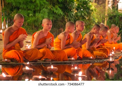 Chiang Mai, Thailand - November 14, 2016: Buddhist monks meditate in Phan Tao Temple during Yi Peng festival in Chiang Mai, Thailand.