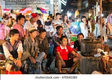 CHIANG MAI, THAILAND - NOVEMBER 15, 2014: Group of people watching football game, Chiang Mai, Thailand.